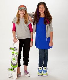 Royalty free photo! Sporty tween girls with a skateboard. There's no cost for using the shots, but we do ask that you credit the photos to us with a link to www.fashionplaytes.com.