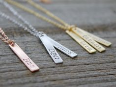 The perfect kids name necklace for mom or grandma. Have your kids names hand-stamped on this personalized vertical bar necklace. Necklace for mommy. Necklace for Grandma.  A beautiful personalized bar necklace, perfect to show your love for your children or grandchildren. You can also have your childs birthdate stamped on a bar as well! _____________________________  ** Please leave your personalization information in the note to seller box at checkout! **  _____________________________ C H…