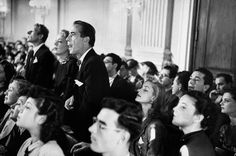Actors (l. to r.) Danny Kaye, June Havoc and Humphrey Bogart (standing) and Bogart's wife actress Lauren Bacall (sitting) listens intently to House Un-American Activities Committee Hearings on the presence of communists in the film industry. October 1947.