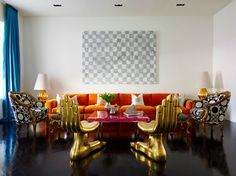 Interior Design by Jonathan Adler  -- love the curtains with the orange, the dark floor with the metallics.