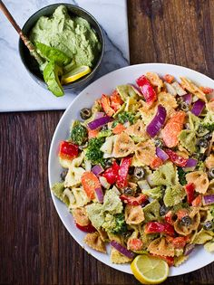 You can enjoy this bow-tie pesto primavera dish served hot or chilled. All the colorful noodles and veggies are tied together by a lemon-tahini dressing plus a creamy avocado-basil pesto.   Source: Happy. Healthy. Life.