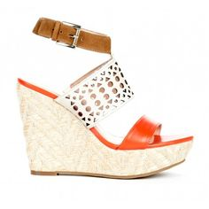 Platform wedge sandal with colorblock and cutout detail.