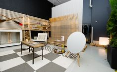 """""""Made in Canada"""" Lounge - Bang and Olufsen Yorkville Speaker, Carpet from FLOR Toronto, Fireplace from Company B, Rocker and Side Table from Stylegarage and Table from Love The Design"""