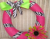 Cute yarn wreaths!  Love the designs & there are college-theme wreaths coming soon.