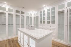 Traditional Closet with Hardwood floors, High ceiling, California Closets Custom Closet, Inset cabinets, Crown molding