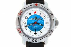 WATCH VOSTOK KOMANDIRSKIE 811055 SUBMARINER. At the top of the watch face, at the twelve-hour point, there is a red five-pointed star. In the center there is a round azure medallion with the image of a submarine riding the waves surrounded by ivory seagulls. #russian #mechanical #military #watches #vostok #komandirskie #navy #sumbarine #anchor #star