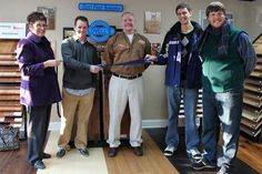 Members of the Fort Thomas Business Association hold a ribbon cutting event with the owners of Lovell's Hardwood Flooring, who recently opened a new showroom on South Fort Thomas Ave. From left: member Debbie Buckley, owner Robert Lovell, owner Al Lovell, member Nick Rolf and member David Gross.