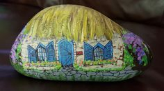 Crooked little cottage with wisteria. Painted rocks. Enid Gjelten Weichselbaum