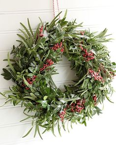 Simple step by step instructions on how to make a fresh holiday wreath using seasonal greens. 2015 Sweet Paul Holiday Countdown: Day 1