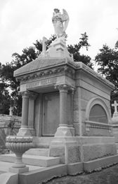 Temple - a tomb design of a scale evocative of a small building. A temple tomb of the classical design will typically display pilasters at each corner or a columned, porticoed facade. Other designs display more elaborate use of columns, structure, and ornament.