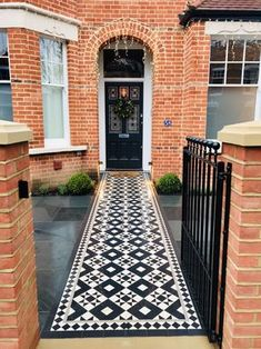 Beautiful Victorian mosaic tile path Double fronted Victorian red brick house with new Victorian mosaic tile installation traditional classic planting scheme including topiary balls rosemary and olive trees. Porch Tile, Victorian Terrace House, Red Brick House, House Front, Front Garden Path, Victorian Front Doors, Victorian Front Garden, Victorian Mosaic Tile, Red Brick Walls