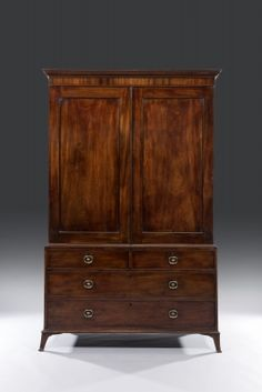 Antique wooden cupboard: 18th Century George III Hepplewhite Period Mahogany Linen Press, stamped Gilllows of Lancaster England Circa 1785