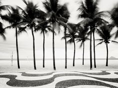 Mosaic sidewalks line the beach in Copacabana.