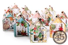 The beautiful mini houses all in rows created by Olga using The Twelve Days of Christmas. Stunning! #graphic45 #christmas