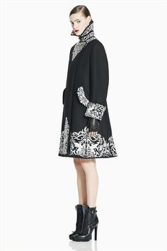 Alexander McQueen Pre-Fall  2012. This coat is a transition between the summer and fall fashions, the coat lengthening and loosing its fitted shape for a more relaxed silhouette.
