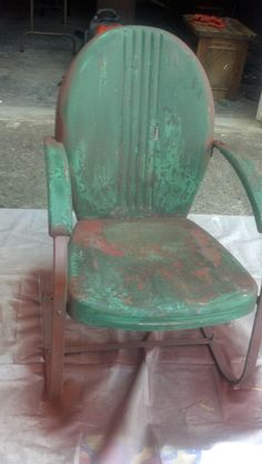 The before picture of the metal chair redo.  This was after stripping and sanding.