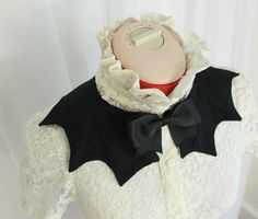 Show your gothic or creepy-cute side with this versatile bat-wing collar. It is fully lined with decorative top stitching, close with removable black