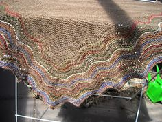 """Made from alpaca fair trade yarn given to me by Holly. I added alpaca (blue) and silk to the border. The design is that of a traditional """"hap"""" or shawl from the Shetlands"""