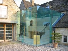 The minimalistic contemporary glass cube within this project connects the main living spaces within this residential development and it was […] House Extension Design, Glass Extension, Interior Exterior, Interior Architecture, Barn House Conversion, Glass Building, Cube Design, Glass Cube, House Extensions