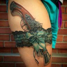 I love the garter not so much the gun.