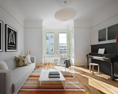 Narrow living room with couch and piano