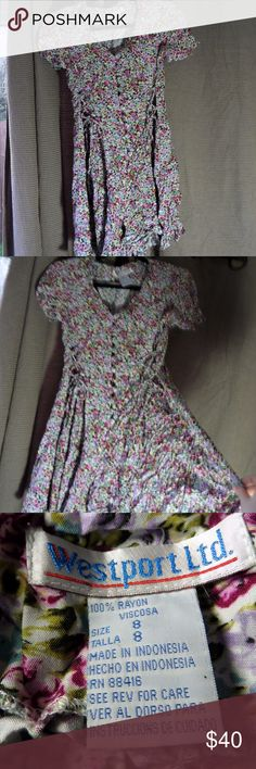 90's vintage floral romper Super cute floral vintage romper. It has corset laces on both sides, fabric covered buttons down the front, and a tie in back. Still has original shoulder pads! EUC Westport LTD Other