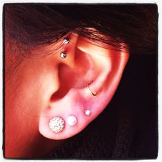 One more piercing to go & then I'll be happy :) Double forward helix, snug, triple lobe // Jewelry: anthropologie, lori mclean, etsy