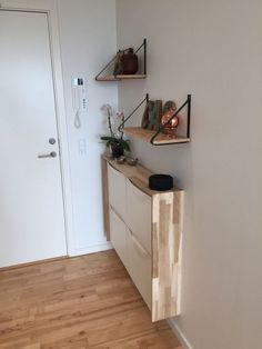 A sleek entryway console of an IKEA Trones item with a plywood waterfall countertop to give it a more stylish look. A sleek entryway console of an IKEA Trones item with a plywood waterfall countertop to give it a more stylish look. Entryway Console, Entryway Storage, Entryway Decor, Entryway Ideas, Apartment Entryway, Ikea Interior, Interior Ideas, Billy Regal Ikea, Entrada Ikea