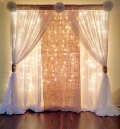 Simple backdrop - burlap, lace, sheer... not sure about flowers on top though.