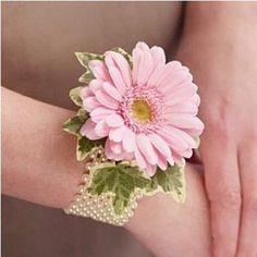 Wrist Corsage: pink Gerber daisy on pearl wristlet