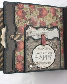 """Hi! I'm back again with a new 6x6 mini-album to share using Prima's """"Stationer's Desk"""". I purchased these 6x6 paper pads about 6 mon..."""