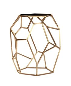 A geometrically sculptural golden tablewith a black marble top, this piece is a beautiful work of art!
