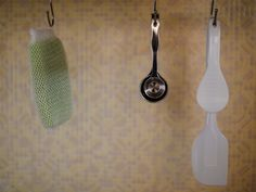 Hanging objects on simple hooks is a clean, popular storage strategy among minimalists.