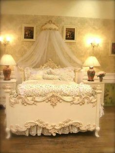 Very ornate bed with Rococo style appliques. You can find similar appliques, hand carved from real beech wood in the Rococo style, including bed rails and centrepieces, at www.buycarvings.co.uk