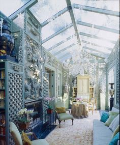 "DESIGNER HUTTON WILKINSON, TONY DUQUETTE INC. RECENTLY CREATED THIS ""WINTER GARDEN"" USING 18TH CENTURY CHINESE PALACE ""SNOWFLAKE"" PATTERNED SCREENS, BACKED WITH MIRROR.  THE FIREPLACE SURROUND WAS ORIGINALLY MADE BY TONY DUQUETTE FOR ""ADRIAN"" C. 1941."