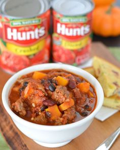 This cozy chili is packed with Italian sausage, butternut squash, tomatoes and beans. It's given a smoky twist with ground chipotle pepper and it perfect for a cool fall night! AD HuntsAtHome