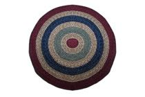 California - Country Burgundy with Sage & Navy Round Braided Rug This high-quality braided rug is made by American workers at our family-owned business in the North Carolina Mountains. It is made from Naturalized Olefin, which is a synthetic, polypropylene yarn that is extremely durable, yet soft enough for use indoors. It is color fast and washable. Visit www.stroudbraided... for more details