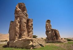 For the last 3,400 years, since 1350 B.C. two gigantic stone statues known as the Colossi of Memnon have been guarding the temple of Pharaoh Amenhotep III, who was worshiped as a god-on-earth both before and after his departure from this world. The massive statues, each about 20 meters high resemble Amenhotep III himself. They got their name after one of the statues, the right one to the north was damaged in an earthquake.