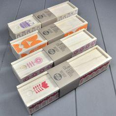 Wooden pencil case - Block printed yo-yo's in orange. £7.50, via Etsy.