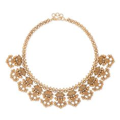 A fantaisie impromptu of intricate gold filigree and geometric shapes reflect the deep warmth of a sunset upon a shimmering desert dune in this luscious necklace.
