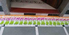Border rangoli designs are usually made at the entrance of pooja room or the house. People also make border rangoli along the exterior wall of the house. Rangoli Designs Photos, Colorful Rangoli Designs, Beautiful Rangoli Designs, Rangoli Colours, Rangoli Patterns, Indian Rangoli, Diwali Rangoli, Flower Petals, Red Flowers