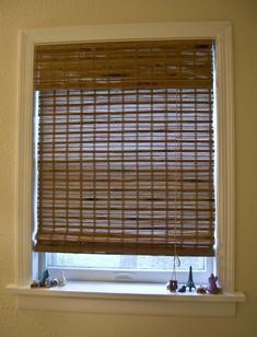 back bamboo shades with fabric for privacy.