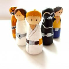 Peg people with a Star Wars theme. Including Chewbacca, Darth Vader, Princess Leia, Hans Solo and Luke Skywalker.