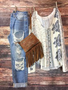 Ursula Top by O'NEILL. Adorable boho blouse paired with destroyed denim and a killer Double J Saddlery wristlet. Westerners fashion. Spring fashion. Boho chic