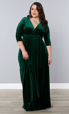 Add a little luxury to your wardrobe with our Garden Estate plus size Velvet Luxe Wrap Dress. This maxi dress is a fully functional wrap dress designed with pure elegance.  Shop our entire made in the USA collection online at www.kiyonna.com.  #Kiyonna #green #velvetdress