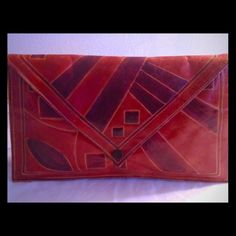 VINTAGE Geometric Envelope Clutch Are you a cool chic? Then this purse is for you Shiny Red & purple trapezoid shaped clutch. In good vintage condition & clean lining. Vintage Bags Clutches & Wristlets