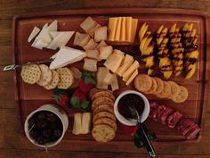 Cheese plate with peaches and charcuterie.