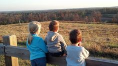 The kids taking in the view from the top of North Wake Landfill Park in Raleigh, NC.