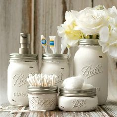 Painted and distressed mason jars for use to hold bathroom accessories. Great…