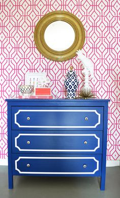 via Adore Home magazine - Blue Ikea Dresser Makeover with O'verlays + pink  geometric wallpaper